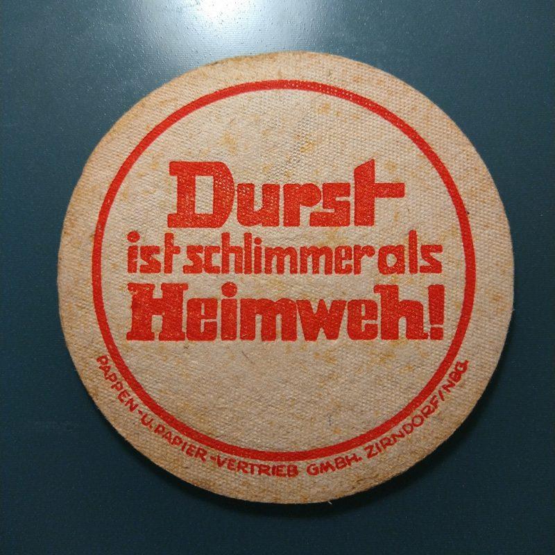biervilt uit de jaren '50 met de tekst 'Durst ist schlimmer als Heimweh!'